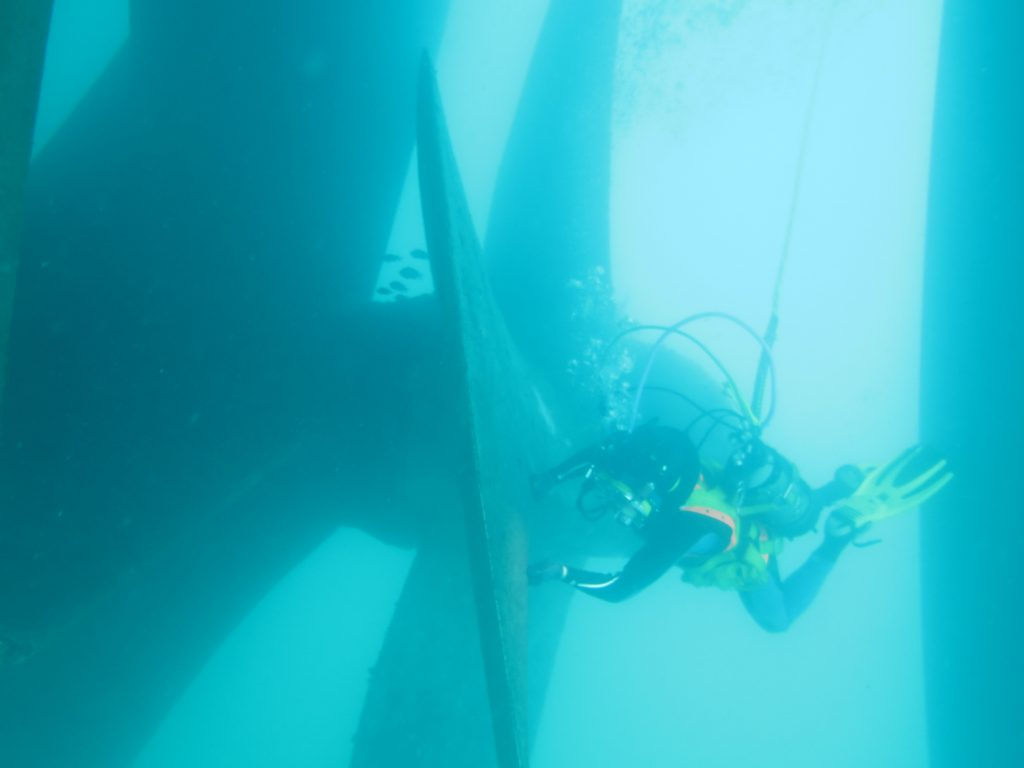 Underwater servicing the propeller and hull